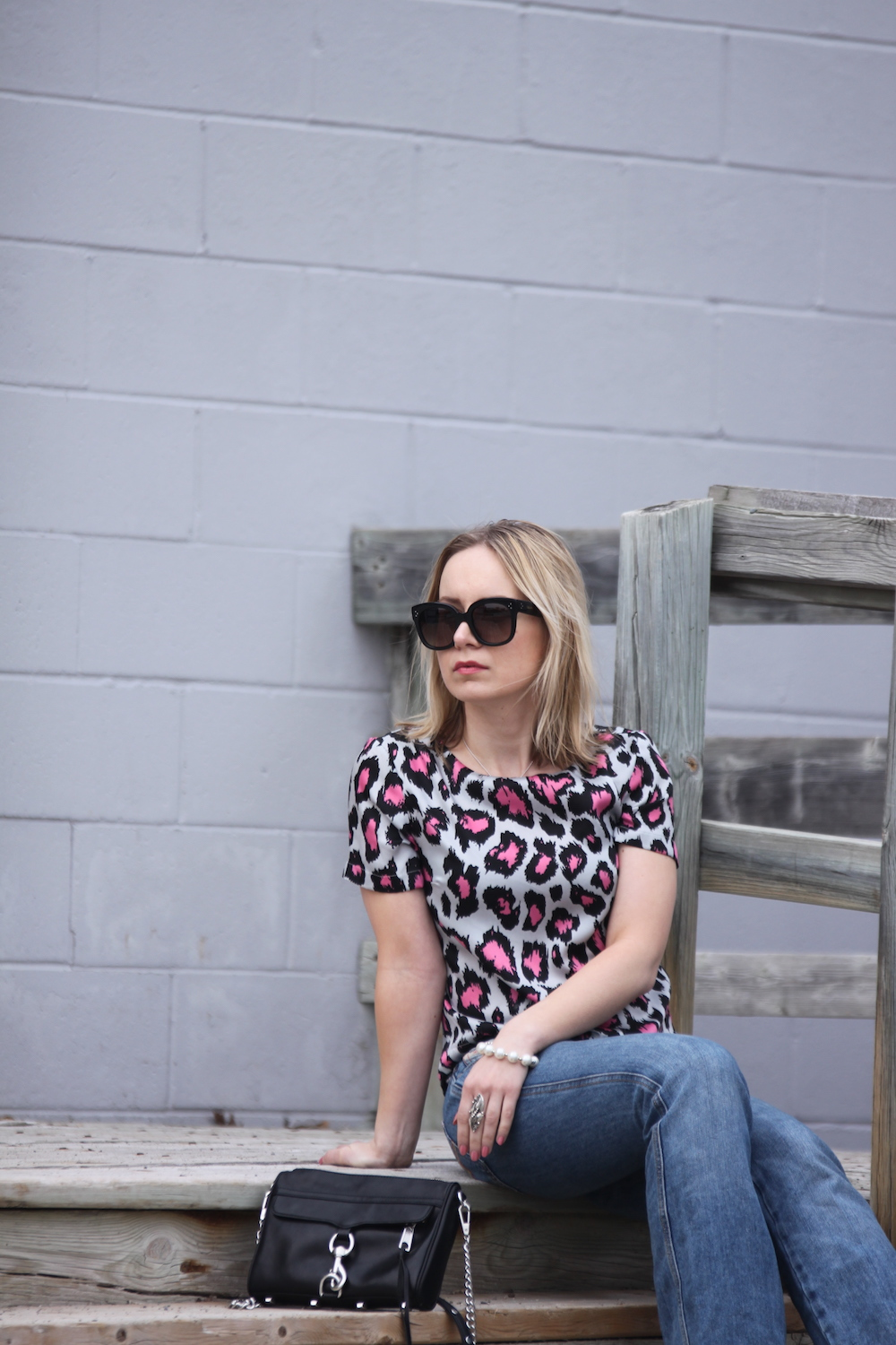 pink leopard top with flared jeans