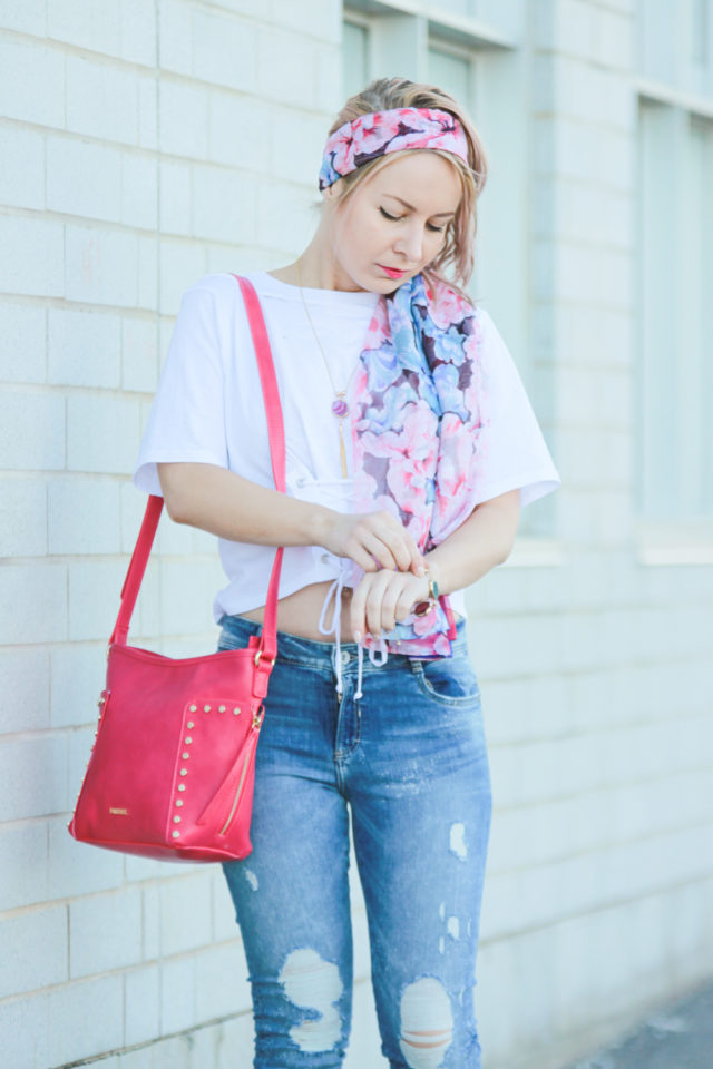 Pink Pinkstix bag and floral headscarf with ripped jeans