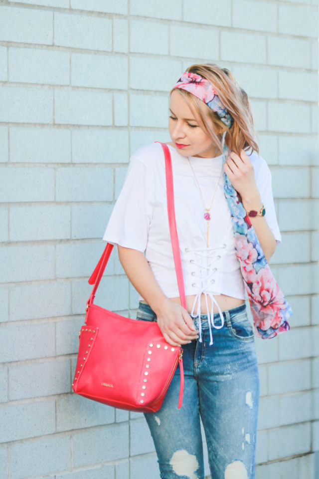 Pinkstix bag with pink floral scarf, corset top and ripped jeans