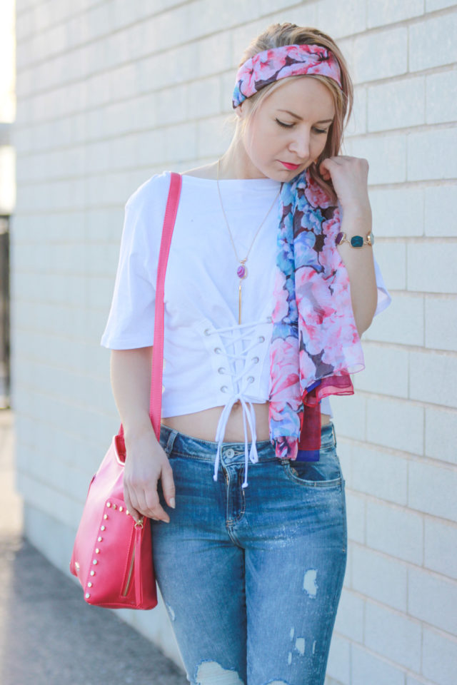 Pink Pinkstix bag and floral headscarf with corset top and ripped jeans