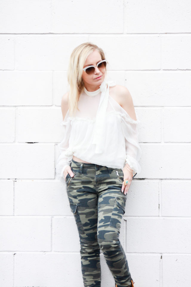cold shoulder blouse with camo jeans and gucci sunnies