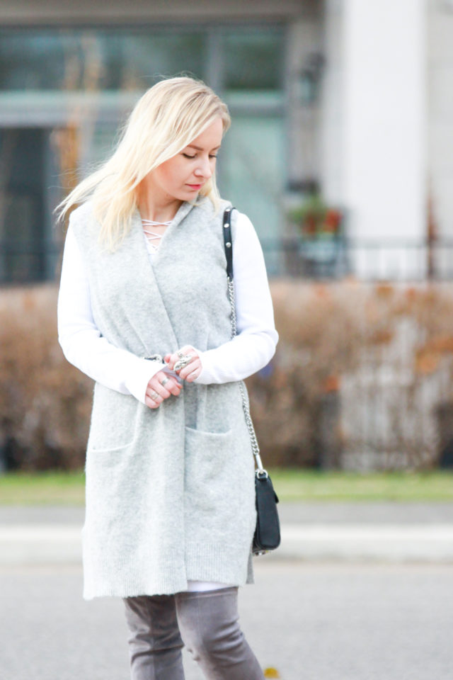 grey vest with pockets and over the knee boots