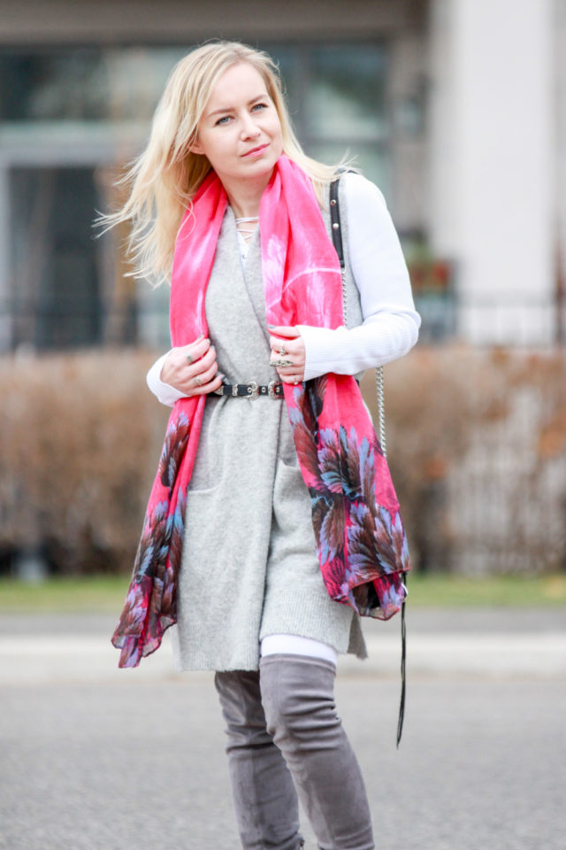 grey vest with pockets and over the knee boots with pink scarf