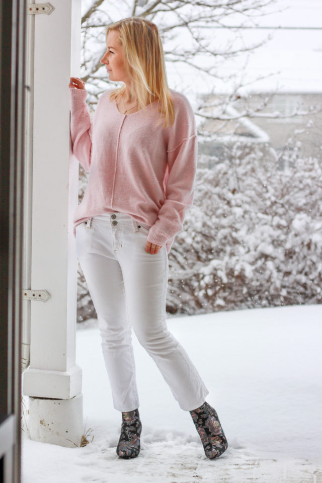 pink topshop sweater with cropped white jeans and floral print boots